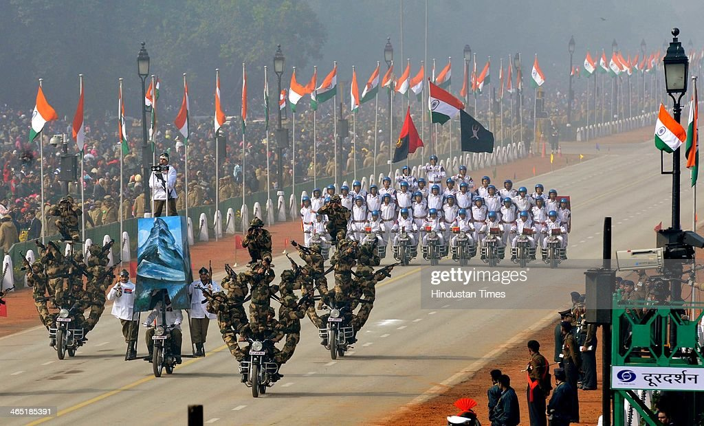 BSF jawans perform on motorcycles during the 65th Republic Day parade at Rajpath on January 26 2014 in New Delhi India India adopted its democratic...