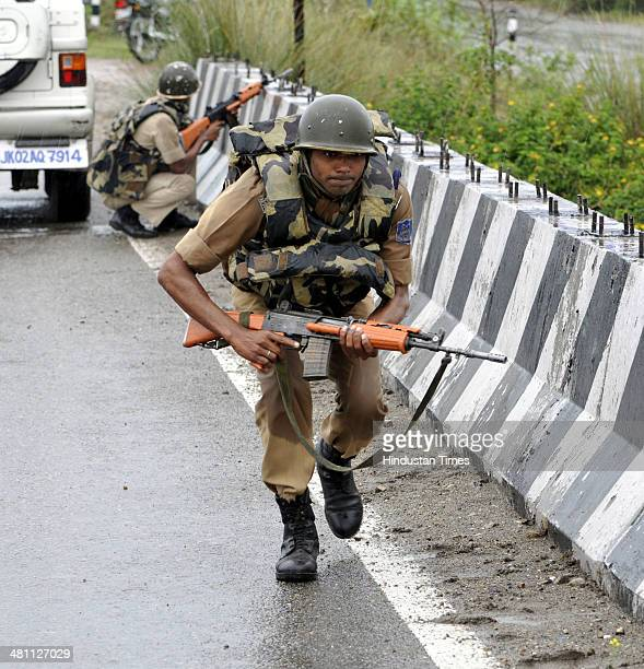 CRPF jawans taking position during an encounter with terrorists at Janglote village on March 28 2014 in Kathua about 80 km from Jammu India In daring...