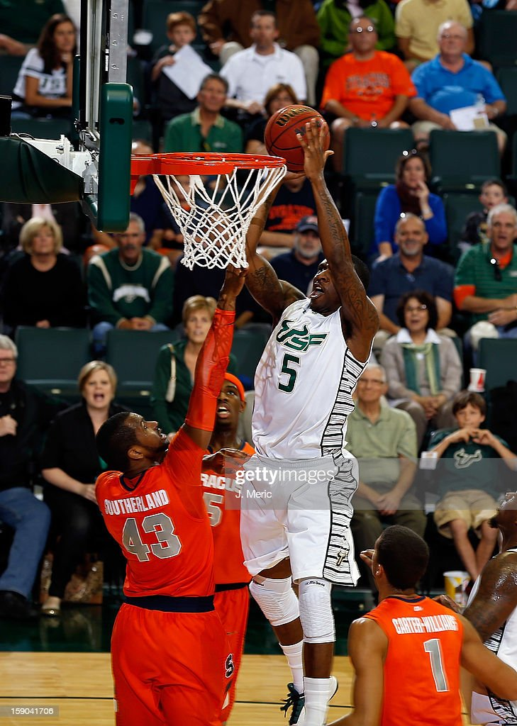 Jawanza Poland #5 of the South Florida Bulls shoots over James Southerland #43 of the Syracuse Orange during the game at the Sun Dome on January 6, 2013 in Tampa, Florida.
