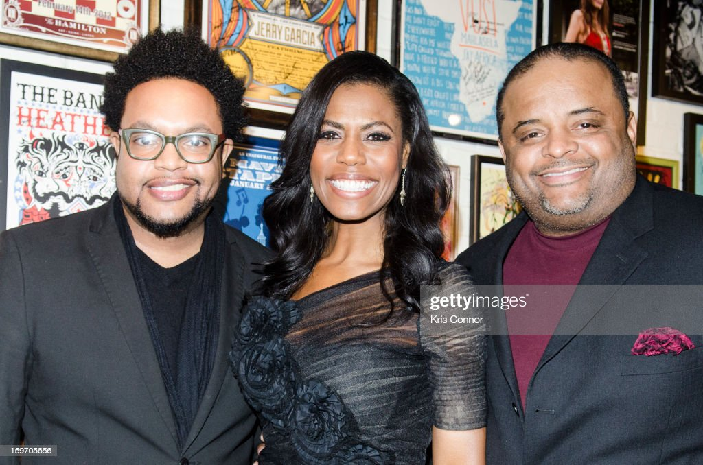 Jawn Murray, Omarosa and Roland S. Martin attend pose for a photo during the St. Jude Children's Research Hospital Inaugural Benefit Reception on January 18, 2013 in Washington, United States.