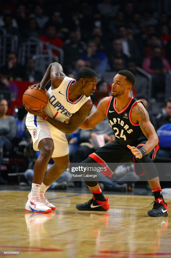 Jawun Evans #1 of the Los Angeles Clippers plays against Norman Powell #24 of the Toronto Raptors on December 11, 2017 at STAPLES Center in Los Angeles, California.