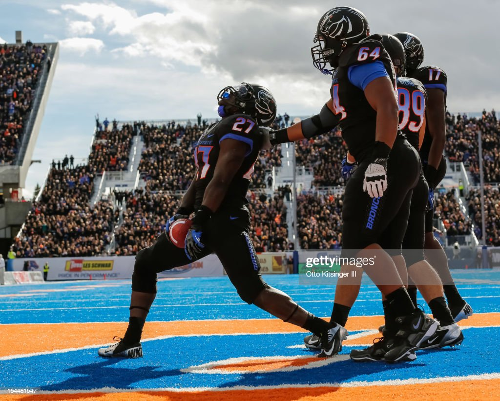 Jay Ajayi #27 of the Boise State Broncos celebrates after a touchdown against the UNLV Rebels at Bronco Stadium on October 20, 2012 in Boise, Idaho.