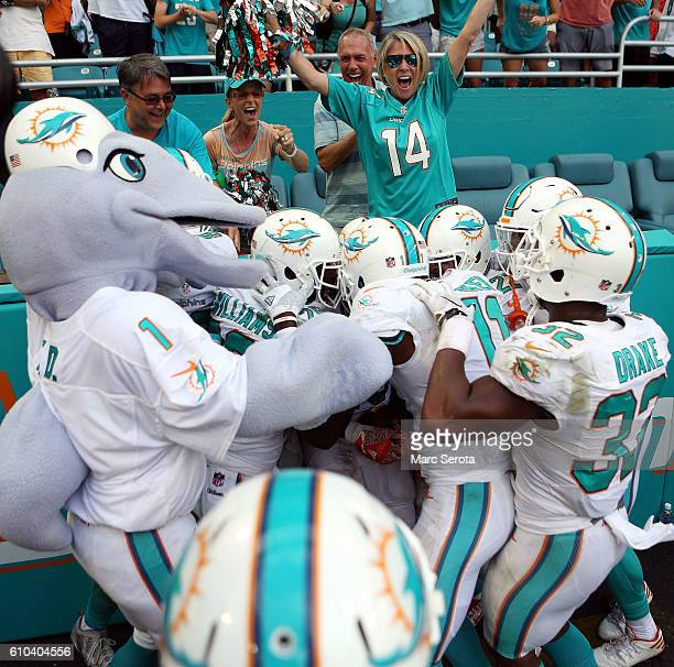 Jay Ajayi of the Miami Dolphins celebrates scoring the winning touchdown against the Cleveland Browns in the first quarter on September 25 2016 in...