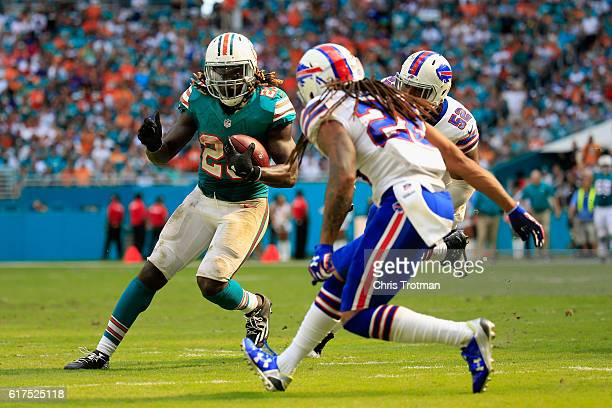 Jay Ajayi of the Miami Dolphins is tackled by Dan Carpenter of the Buffalo Bills at the Hard Rock Stadium on October 23 2016 in Miami Gardens Florida