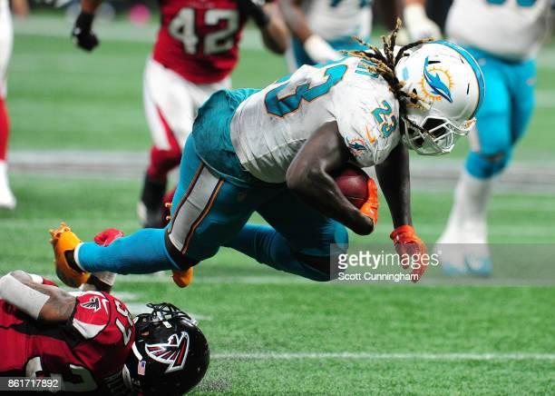 Jay Ajayi of the Miami Dolphins is tackled by Ricardo Allen of the Atlanta Falcons at MercedesBenz Stadium on October 15 2017 in Atlanta Georgia
