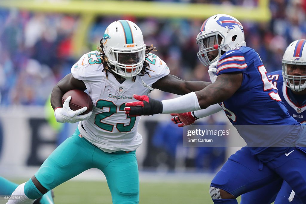 Jay Ajayi #23 of the Miami Dolphins runs against the Buffalo Bills during the first half at New Era Stadium on December 24, 2016 in Orchard Park, New York.