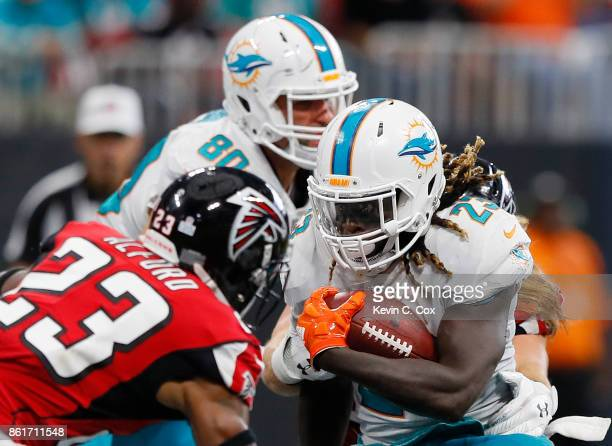 Jay Ajayi of the Miami Dolphins rushes against Robert Alford of the Atlanta Falcons at MercedesBenz Stadium on October 15 2017 in Atlanta Georgia