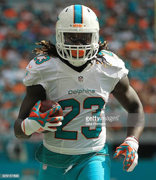 Jay Ajayi of the Miami Dolphins rushes during a game against the Arizona Cardinals at Hard Rock Stadium on December 11 2016 in Miami Gardens Florida