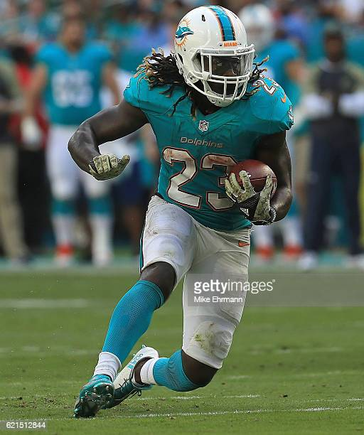 Jay Ajayi of the Miami Dolphins rushes during a game against the New York Jets at Hard Rock Stadium on November 6 2016 in Miami Gardens Florida