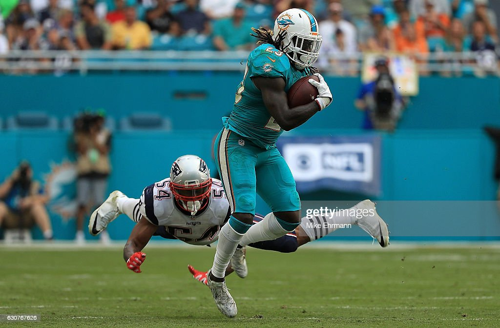 Jay Ajayi #23 of the Miami Dolphins rushes during a game against the New England Patriots at Hard Rock Stadium on January 1, 2017 in Miami Gardens, Florida.