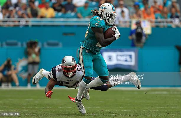 Jay Ajayi of the Miami Dolphins rushes during a game against the New England Patriots at Hard Rock Stadium on January 1 2017 in Miami Gardens Florida