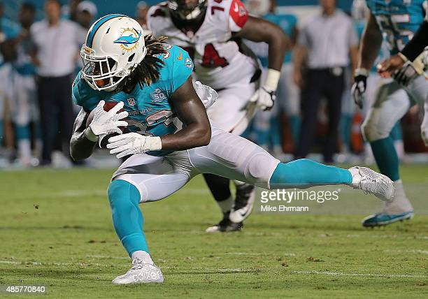Jay Ajayi of the Miami Dolphins rushes during a preseason game against the Atlanta Falcons at Sun Life Stadium on August 29 2015 in Miami Gardens...