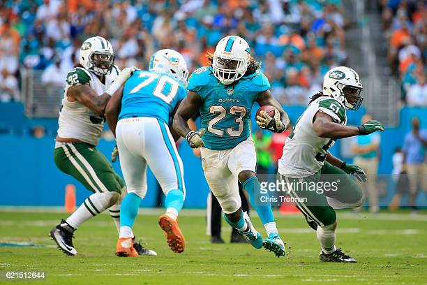 Jay Ajayi of the Miami Dolphins rushes with the ball against the New York Jets at the Hard Rock Stadium on November 6 2016 in Miami Gardens Florida