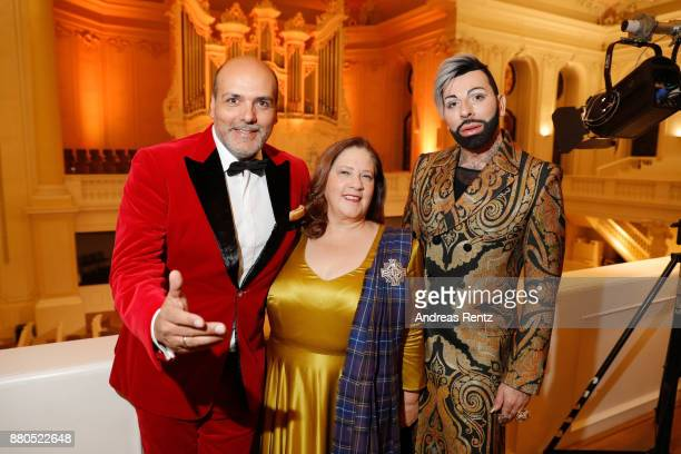 Jay Alexander Kathy Kelly and Harald Gloeoeckler pose for a photograph prior to designer Harald Gloeoeckler gives a christmas sermon in the...