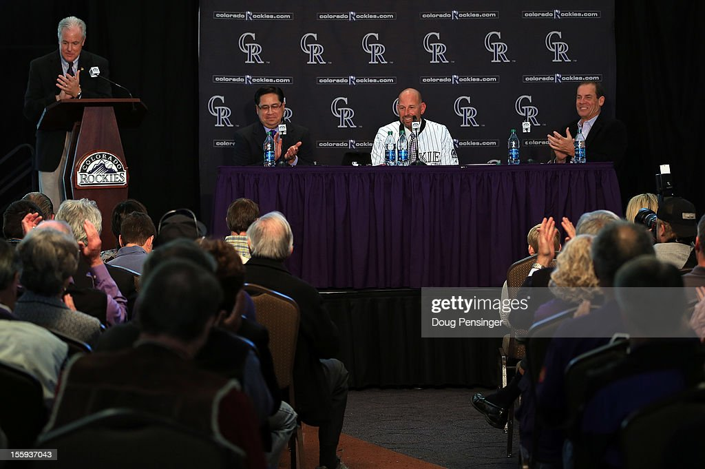 Jay Alves Vice President - Communications/Public Relations of the Colorado Rockies conducts the proceedings as Bill Geivett Senior Vice President of Scouting and Player Developement/Assistant General Manager of the Colorado Rockies presents <a gi-track='captionPersonalityLinkClicked' href=/galleries/search?phrase=Walt+Weiss&family=editorial&specificpeople=239045 ng-click='$event.stopPropagation()'>Walt Weiss</a> as manager of the Rockies along with Dick Monfort Owner/Chairman and CEO of the Rockies during a press conference at Coors Field on November 9, 2012 in Denver, Colorado.