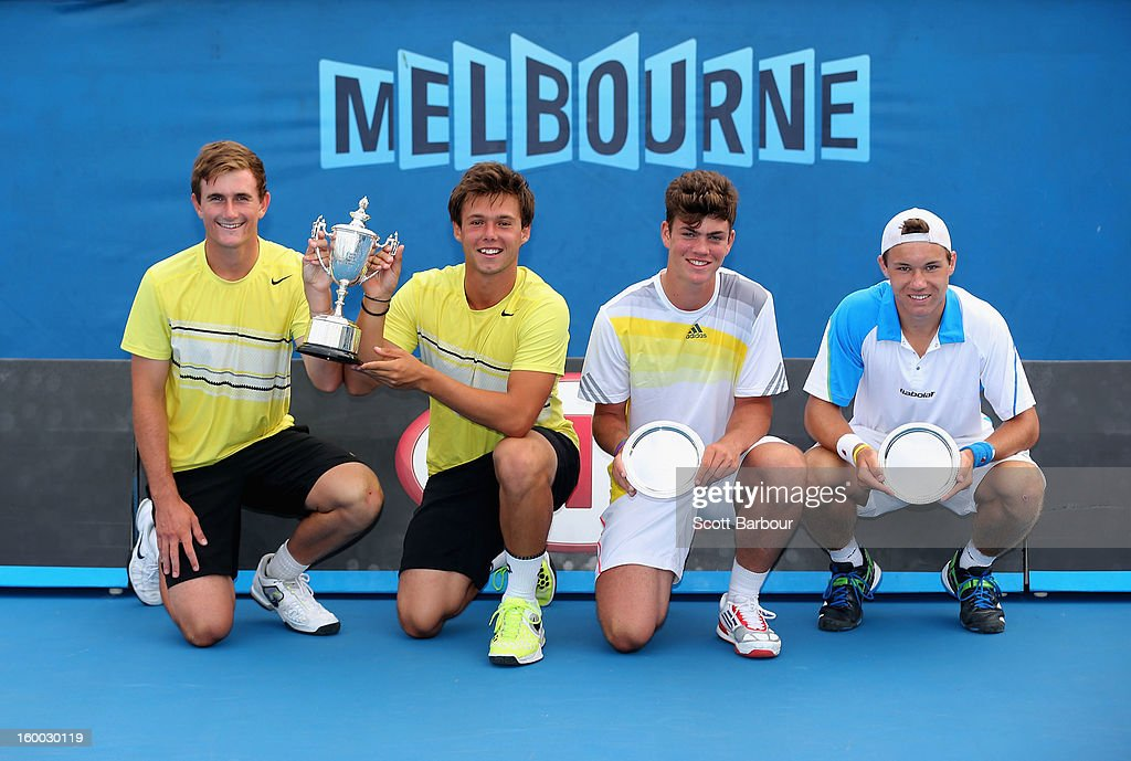 Jay Andrijic and Bradley Mousley of Australia pose with the championship trophy alongside Maximilian Marterer of Germany and Lucas Miedler of Austria after the Junior Boys' Doubles Final match during the 2013 Australian Open Junior Championships at Melbourne Park on January 25, 2013 in Melbourne, Australia.