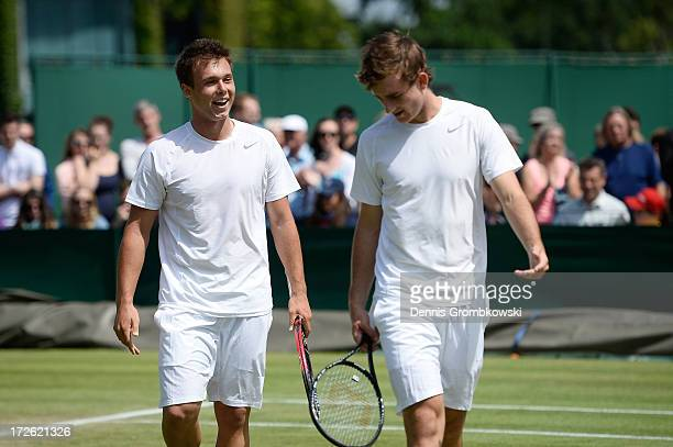 Jay Andrijic of Australia and Bradley Mousley of Australia talk tactics during the Boys' Doubles second round match against Benjamin Bonzi of France...