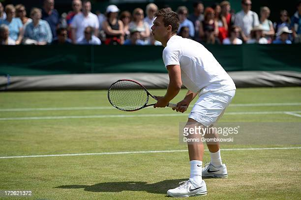 Jay Andrijic of Australia awaits a serve during the Boys' Doubles second round match against Benjamin Bonzi of France and Quentin Halys of France on...