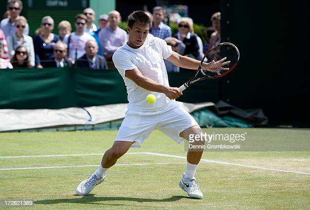 Jay Andrijic of Australia hits a backhand during the Boys' Doubles second round match against Benjamin Bonzi of France and Quentin Halys of France on...