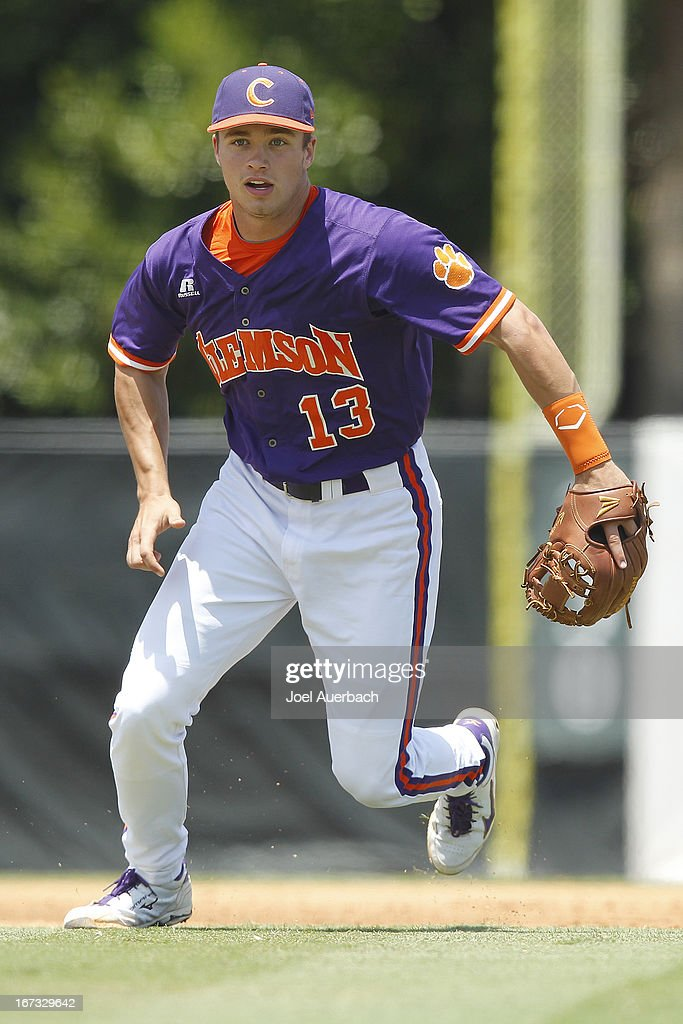 Jay Baum #13 of the Clemson Tigers runs towards home plate to defend against a possible bunt by the Miami Hurricanes on April 21, 2013 at Alex Rodriguez Park at Mark Light Field in Coral Gables, Florida. Miami defeated Clemson 7-0.