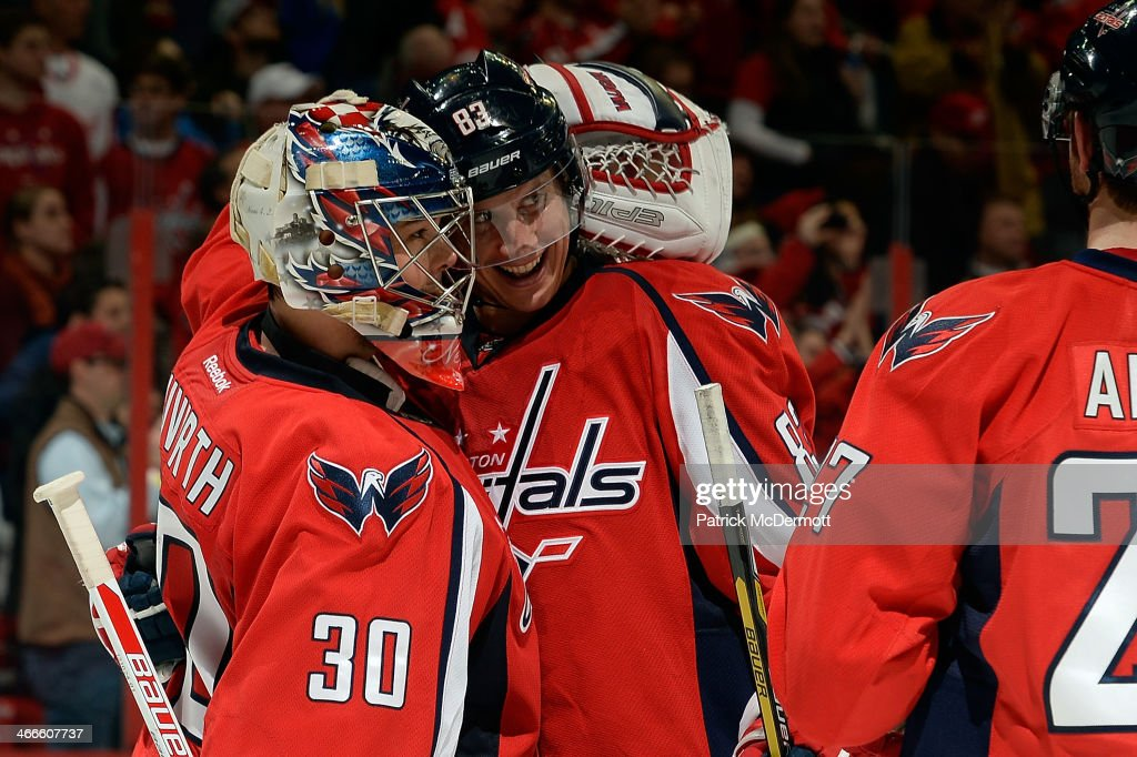 <a gi-track='captionPersonalityLinkClicked' href=/galleries/search?phrase=Jay+Beagle&family=editorial&specificpeople=4671535 ng-click='$event.stopPropagation()'>Jay Beagle</a> #83 celebrates with <a gi-track='captionPersonalityLinkClicked' href=/galleries/search?phrase=Michal+Neuvirth&family=editorial&specificpeople=3205600 ng-click='$event.stopPropagation()'>Michal Neuvirth</a> #30 of the Washington Capitals after the Capitals defeated the Detroit Red Wings 6-5 in overtime during an NHL game at Verizon Center on February 2, 2014 in Washington, DC.
