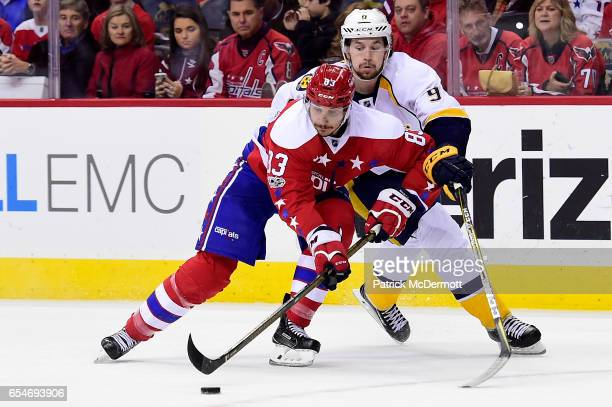 Jay Beagle of the Washington Capitals and Filip Forsberg of the Nashville Predators battle for the puck in overtime during an NHL game at Verizon...