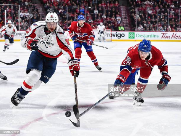 Jay Beagle of the Washington Capitals and Nathan Beaulieu of the Montreal Canadiens chase the puck during the NHL game at the Bell Centre on February...