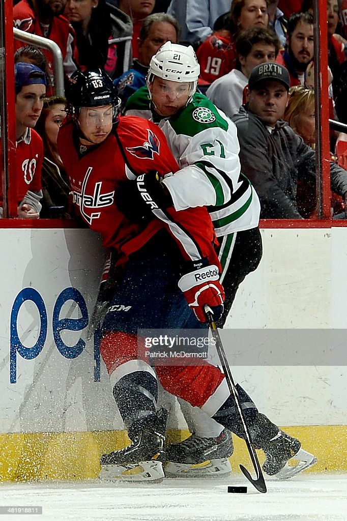 <a gi-track='captionPersonalityLinkClicked' href=/galleries/search?phrase=Jay+Beagle&family=editorial&specificpeople=4671535 ng-click='$event.stopPropagation()'>Jay Beagle</a> #83 of the Washington Capitals battles for the puck against <a gi-track='captionPersonalityLinkClicked' href=/galleries/search?phrase=Antoine+Roussel&family=editorial&specificpeople=4202700 ng-click='$event.stopPropagation()'>Antoine Roussel</a> #21 of the Dallas Stars in the second period during an NHL game at Verizon Center on April 1, 2014 in Washington, DC.