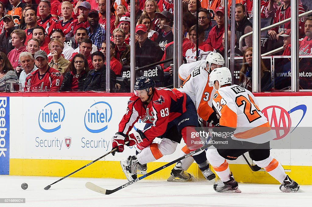 Jay Beagle of the Washington Capitals battles for the puck against Radio Gudas of the Philadelphia Flyers in the first period in Game Two of the...