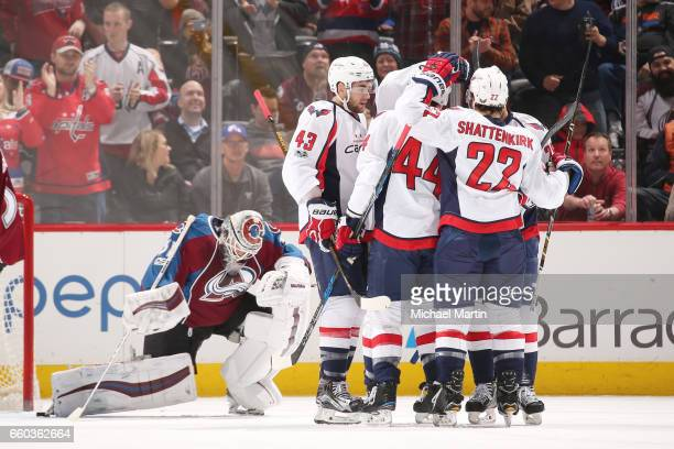 Jay Beagle of the Washington Capitals celebrates a goal against the Colorado Avalanche with teammates Tom Wilson Brooks Orpik and Kevin Shattenkirk...