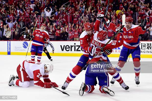 Jay Beagle of the Washington Capitals celebrates his third period goal with teammate Tom Wilson during a NHL game against the Detroit Red Wings at...