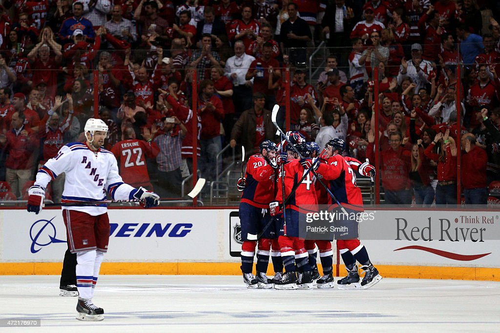 <a gi-track='captionPersonalityLinkClicked' href=/galleries/search?phrase=Jay+Beagle&family=editorial&specificpeople=4671535 ng-click='$event.stopPropagation()'>Jay Beagle</a> #83 of the Washington Capitals celebrates with teammates after scoring a goal against the New York Rangers during the second period in Game Three of the Eastern Conference Semifinals during the 2015 NHL Stanley Cup Playoffs at Verizon Center on May 4, 2015 in Washington, DC.
