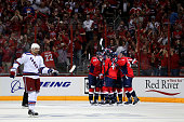 Jay Beagle of the Washington Capitals celebrates with teammates after scoring a goal against the New York Rangers during the second period in Game...