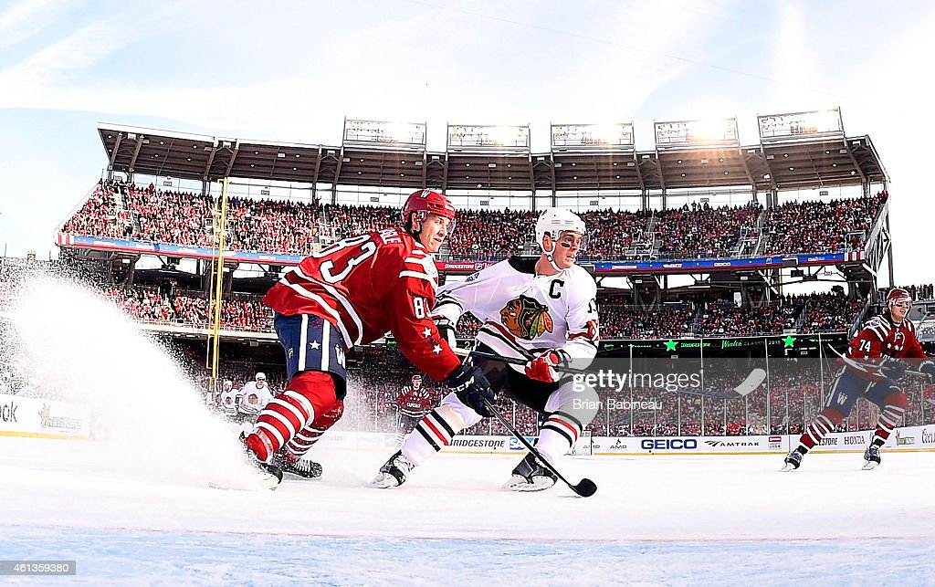 <a gi-track='captionPersonalityLinkClicked' href=/galleries/search?phrase=Jay+Beagle&family=editorial&specificpeople=4671535 ng-click='$event.stopPropagation()'>Jay Beagle</a> #83 of the Washington Capitals defends <a gi-track='captionPersonalityLinkClicked' href=/galleries/search?phrase=Jonathan+Toews&family=editorial&specificpeople=537799 ng-click='$event.stopPropagation()'>Jonathan Toews</a> #19 of the Chicago Blackhawks in the slot area in the second period of the 2015 Bridgestone NHL Winter Classic at Nationals Park on January 1, 2015 in Washington, D.C.