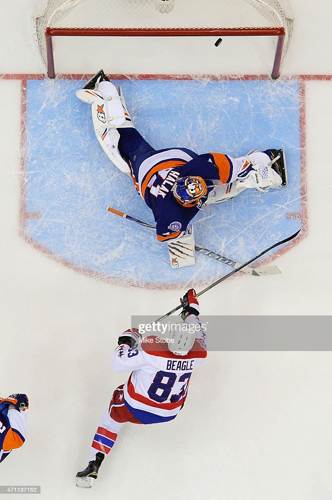 Jay Beagle of the Washington Capitals hits the crossbar against Jaroslav Halak of the New York Islanders in the third period during Game Six of the...