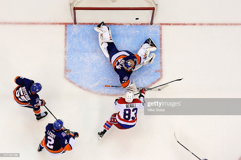 <a gi-track='captionPersonalityLinkClicked' href=/galleries/search?phrase=Jay+Beagle&family=editorial&specificpeople=4671535 ng-click='$event.stopPropagation()'>Jay Beagle</a> #83 of the Washington Capitals hits the crossbar against <a gi-track='captionPersonalityLinkClicked' href=/galleries/search?phrase=Jaroslav+Halak&family=editorial&specificpeople=2285591 ng-click='$event.stopPropagation()'>Jaroslav Halak</a> #41 of the New York Islanders in the third period during Game Six of the Eastern Conference Quarterfinals during the 2015 NHL Stanley Cup Playoffs at Nassau Veterans Memorial Coliseum on April 25, 2015 in Uniondale, New York. The Islanders defeated the Capitals 3-1.