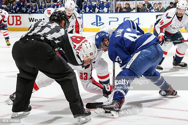 Jay Beagle of the Washington Capitals takes a faceoff against Nazem Kadri of the Toronto Maple Leafs during the third period at the Air Canada Centre...