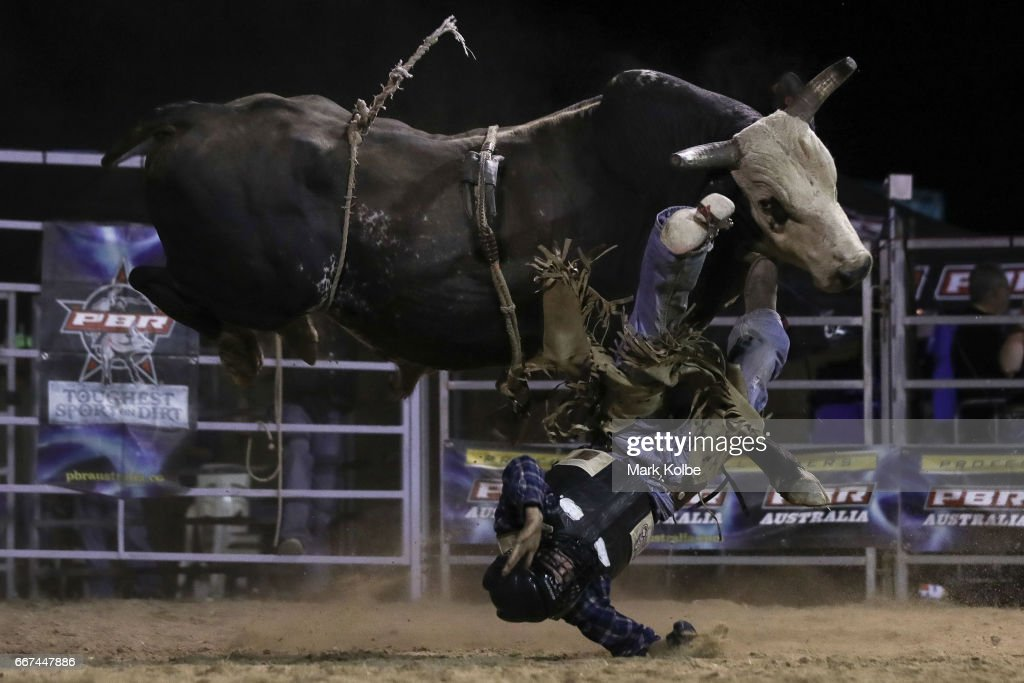 Jay Borghero of Rockhampton is thrown off by Hotter Than Hell 2 as he competes during the Julia Creek Dirt 'n' Dust PBR Bull Riding event which is part of the Julia Creek Dirt 'n' Dust Festival 2017 on April 8, 2017 in Julia Creek, Australia.
