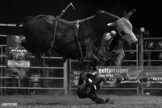 Jay Borghero of Rockhampton is thrown off by Hotter Than Hell 2 in the PBR Bull Riding competition during the Dirt 'n' Dust Festival 2017 on April 8...