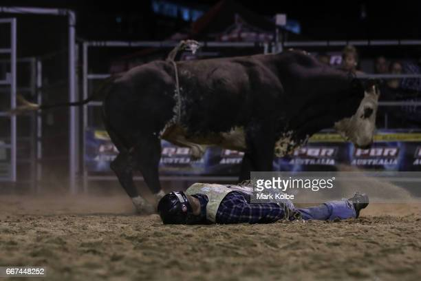 Jay Borghero of Rockhampton lies motionless after being injured by Hotter Than Hell 2 after being thrown while competing during the Julia Creek Dirt...