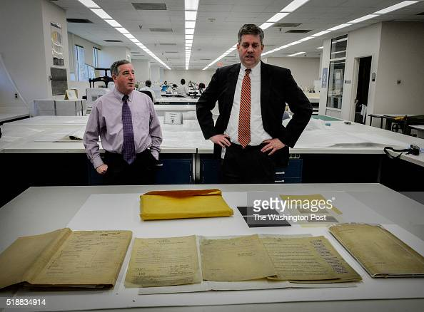Jay Bosanko COO of the National Archives right and Mitch Yockelson Investigative Archivist look over the patent documents for the Wright brothers...