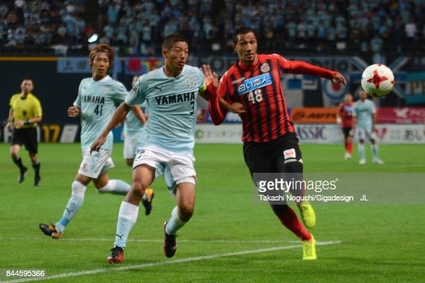 Jay Bothroyd of Consadole Sapporo and Kentaro Oi of Jubilo Iwata compete for the ball during the JLeague J1 match between Consadole Sapporo and...