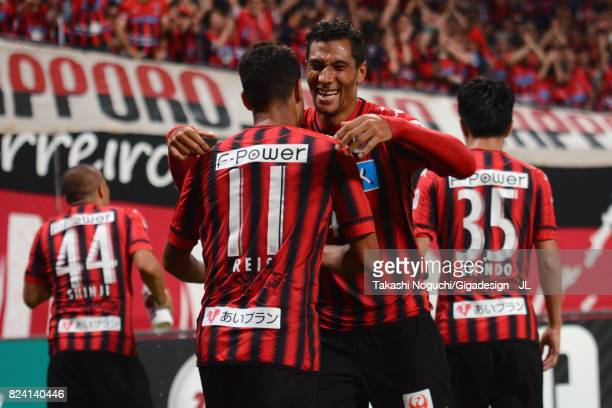 Jay Bothroyd of Consadole Sapporo celebrates scoring his side's second goal with his team mate Reis during the JLeague J1 match between Consadole...