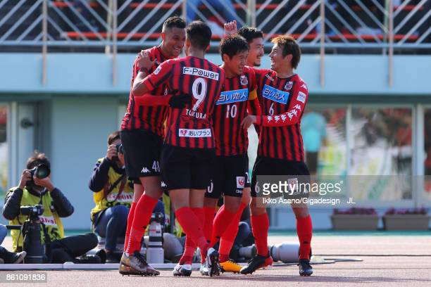 Jay Bothroyd of Consadole Sapporo celebrates scoring his side's second goal with his team mates during the JLeague J1 match between Consadole Sapporo...