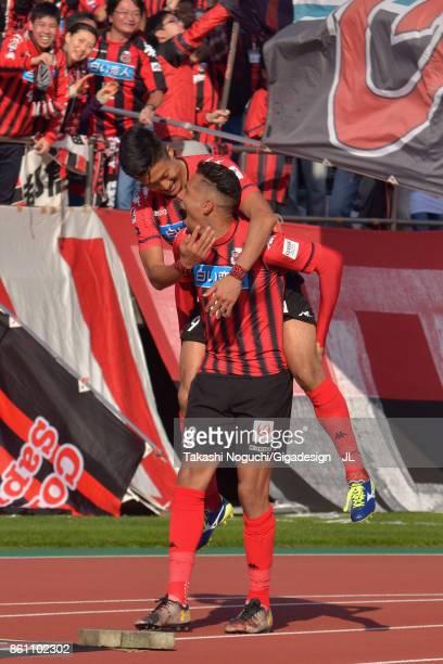 Jay Bothroyd of Consadole Sapporo celebrates scoring his side's third goal with Ken Tokura of Consadole Sapporo during the JLeague J1 match between...