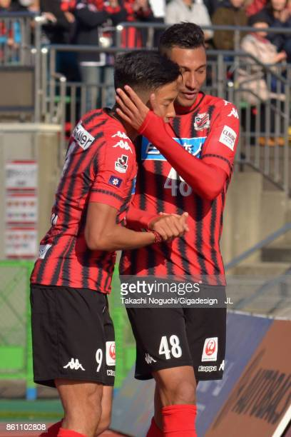 Jay Bothroyd of Consadole Sapporo celebrates scoring his side's third goal with Ken Tokura of Consadole Sapporo during the JLeague J1 match between...