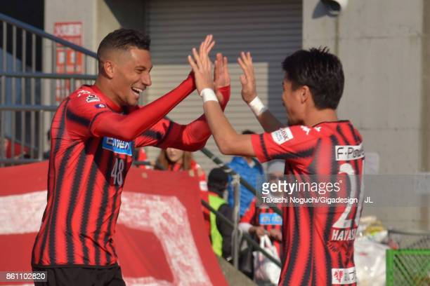 Jay Bothroyd of Consadole Sapporo celebrates scoring his side's third goal with his team mate during the JLeague J1 match between Consadole Sapporo...