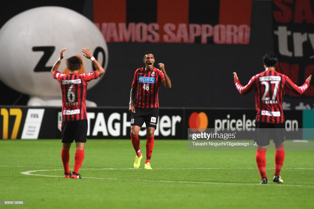 Jay Bothroyd (C) of Consadole Sapporo celebrates scoring the opening goal during the J.League J1 match between Consadole Sapporo and Ventforet Kofu at Sapporo Dome on August 13, 2017 in Sapporo, Hokkaido, Japan.