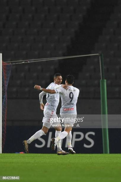 Jay Bothroyd of Consadole Sapporo celebrates scoring the opening goal with his team mate Ken Tokura during the JLeague J1 match between FC Tokyo and...