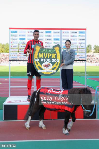Jay Bothroyd of Consadole Sapporo poses with Pony Cicci for photographs during the ceremony after the JLeague J1 match between Consadole Sapporo and...